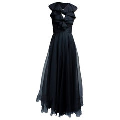 Christian Dior black opened back silk evening dress. circa 1970s