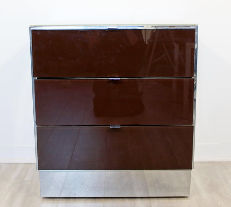 For your consideration is a marvelous pair of mirrored cabinets, nightstands with three drawers each, by Ello, circa 1980s. In very good vintage condition. The dimensions are 24.5