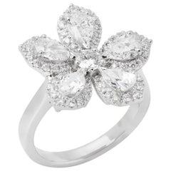 Diamond Platinum Micro Set Pear and Round Brilliant Cut Diamond Cluster Ring