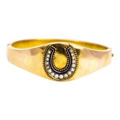 Edwardian Pearl and Enamel Yellow Gold Horseshoe Bangle