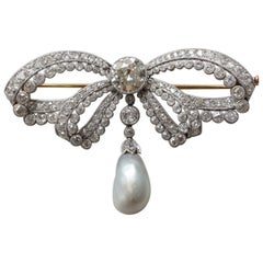 Edwardian Platinum and Gold Bow Brooch with Diamonds and Pearl