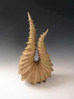 """""""Upon Itself"""" radiates fins spiraling around a tapering coiled ceramic form."""