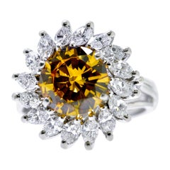 Fancy Cognac Diamond, 2.68 Carat Surrounded by White Diamond in a Platinum Ring