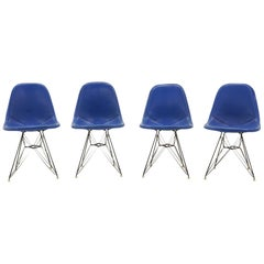 Four Eames Black Wire DKR Dining Chairs, Eiffel Tower Bases, Blue Bikini Covers