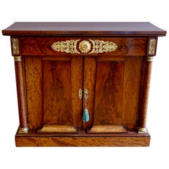 French Empire Period Flame Mahogany and Parcel-Gilt Cabinet