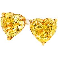 GIA Certified 10.12 Carat Fancy Vivid Yellow Heart Shape Diamond Stud Earrings