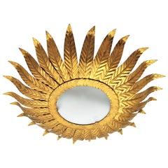 Gilt Metal Sunburst Light Fixture with Frosted Glass / Sunburst Wall Mirror
