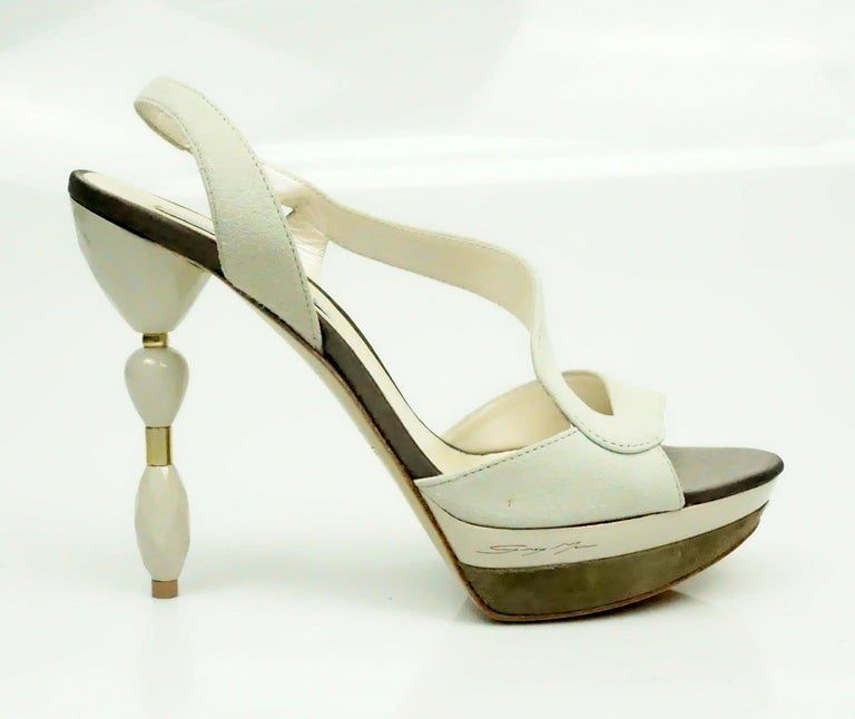 Grey Mer Bone Suede Sandal w/ Acrylic Heel - 37  These unique heels are in excellent condition. The bottom of the heels seem to look as if they have never been worn. There is a suede and patent leather platform on the shoe and the heel has an