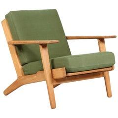Hans J. Wegner Lounge Chair GE 290 of Oak and Green Wool by GETAMA, 1970s