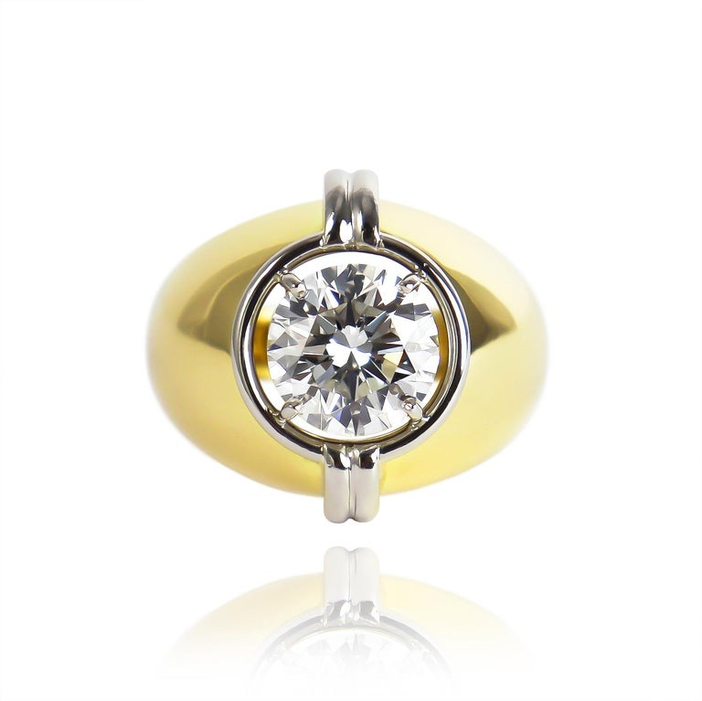 This incredible, newly restored, vintage Harry Winston solitaire features a GIA certified 3.01 carat brilliant round diamond of G color and VS1 clarity... This bold, two-tone ring frames this important diamond with curvilinear metalwork, clean