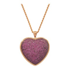 Heart Shaped Pendant in Rubies Pave and 18 Karat Pink Gold