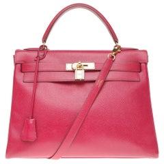 Hermès Kelly 32 retourné shoulder bag in red courchevel leather, gold hardware