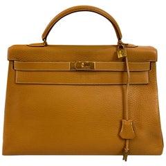 Hermès Kelly Retourne Handbag Gold Fjord Leather with Gold Hardware 40, 1985.