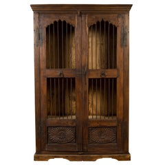 Indian Antique Cabinet with Pierced Doors, Carved Motifs and Bronze Spindles