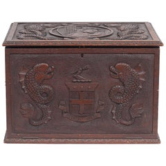 Italian Carved Walnut Captain's Box with Sea Monsters, Coat of Arms and Dolphins