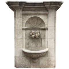 Large Hand-Carved Limestone Wall Fountain from France Featuring Grapevine Spout