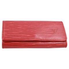Louis Vuitton multi keys  in red épi leather.
