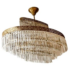 Luxurious Oval Shaped Crystal and Brass Hollywood Regency Chandelier