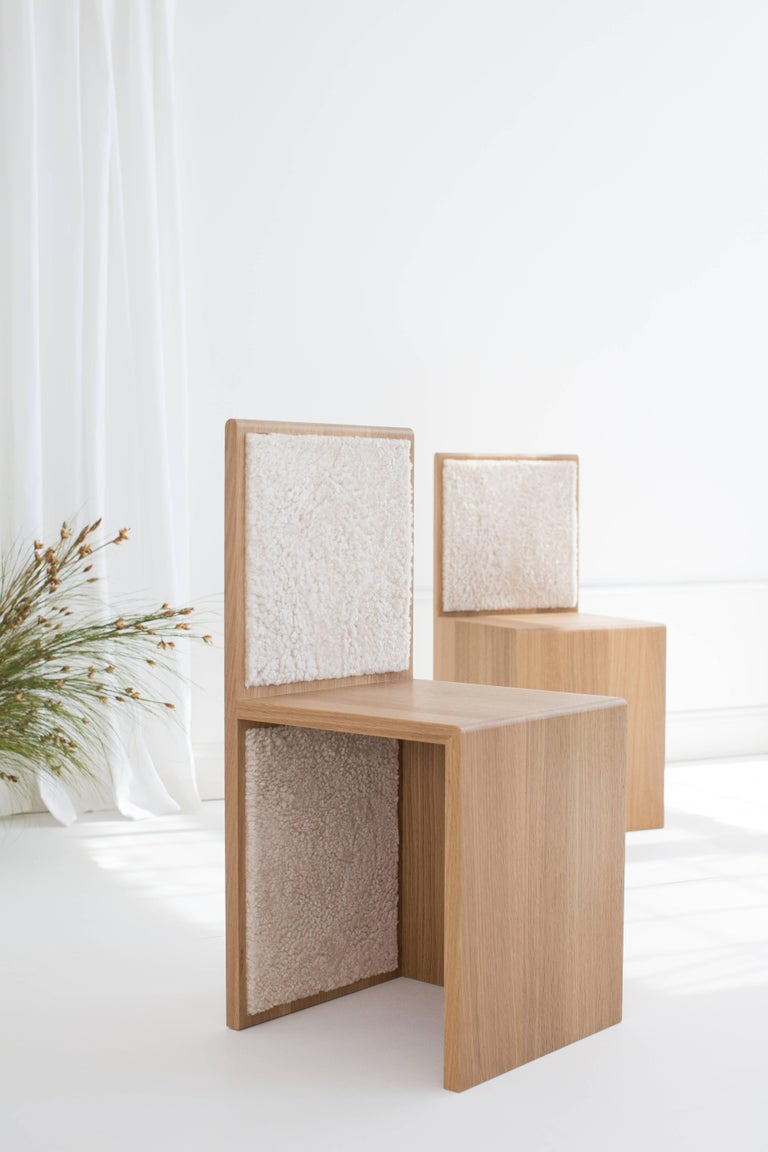 Designed by Ben & Aja Blanc, the Marfa chair is made from solid rift white oak and inlaid with Australian short-cut curly shearling. The side chair can be purchased as a