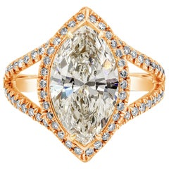 Marquise Cut Diamond Halo Engagement Ring in Rose Gold