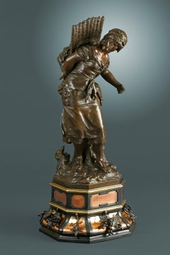 """19th Century sculpture of Female in Bronze, titled """"The Berry Gatherer"""""""