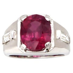 Men's Ring 6 Carat Oval Ruby Flanked by Baguette Diamonds Matte Finish 18K Gold