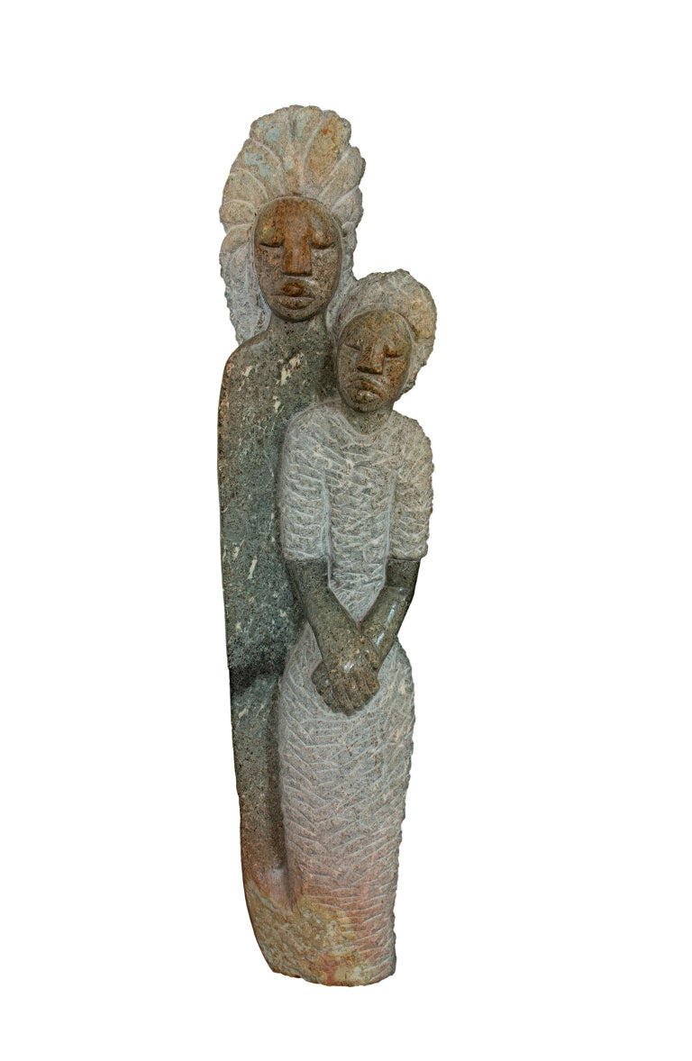 """Together We Stand"" is an original opal stone sculpture by Shona sculptor Obert Mukumbi. The artist signed the piece on the bottom. The piece weighs approximately 70 lbs. It features two figures standing tall with multiple textures carved into the"