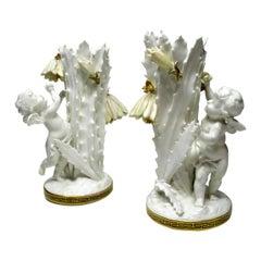 Pair of English Moore Brothers Porcelain Cream Gilt Cherub Vases Centerpieces