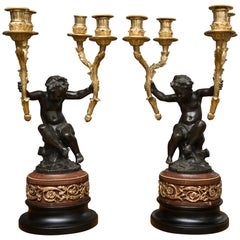 Pair of 19th Century French Gilt and Patinated Bronze Cherubs as Candelabra