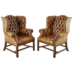 Pair of English Georgian Cigar Leather Wingback Library Chairs