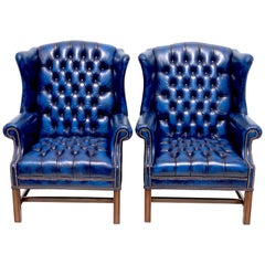 Pair of English Hollywood Regency blue leather Wing Back Chesterfield Chairs