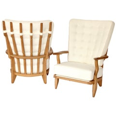 Guillerme et Chambron Votre Maison Pair of French Oak Grand Repos Lounge Chairs