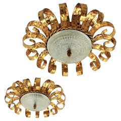 Pair of Gilt Iron & Glass Sunburst Crown Ceiling Flush Mounts with Scroll Motif