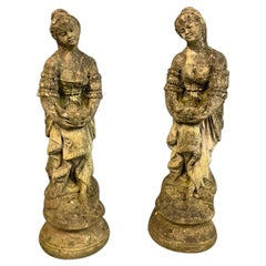 Pair of Mid-20th Century Reconstituted Stone Figures of Girls Holding Doves