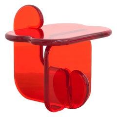 Plump resin side table in Amaro Orange by Ian Alistair Cochran