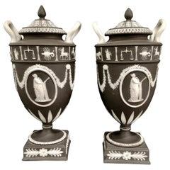 Pair of English Jasperware Lidded Black-Ground Wedgwood Vases with Zodiac Panels