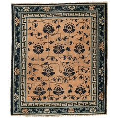 Rare Antique Chinese Ningxia Rug with Blue Lotus Flowers on a Blush Pink Field