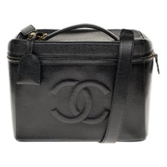 Rare Chanel Vanity Case in Caviar black leather with strap , gold hardware