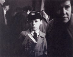 Young Lad ( haunting portrait of young boy on a crowded London street)