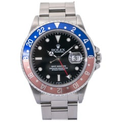 Rolex GMT Master 16700, Black Dial, Certified and Warranty
