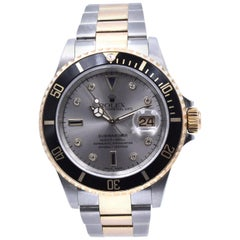Rolex Submariner Stainless Steel & 18 Karat Yellow Gold Black Submariner with Gr