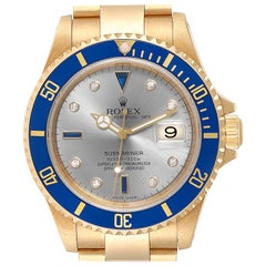 Rolex Submariner Yellow Gold Diamond Sapphire Serti Dial Watch 16618