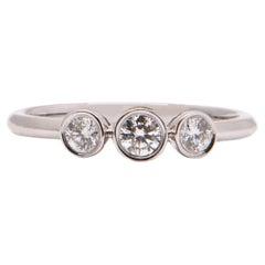 Round Brilliant Cut Diamond Trilogy Ring in 18 Carat White Gold