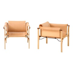 Saddle Stitched Leather Lounge Chairs, by Valdes