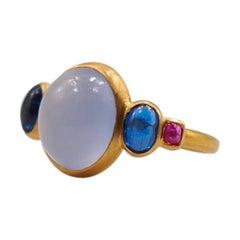 Scrives 5.27 Carat Blue Chalcedony Kyanite Ruby Cabochon 22 Karat Gold Ring