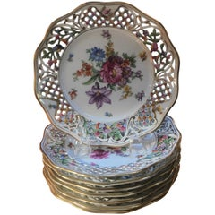 Set of Eight Porcelain Reticulated Luncheon Plates