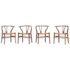 Set of Four Danish Wishbone Chairs CH 24 by Hans J. Wegner for Carl Hansen Oak