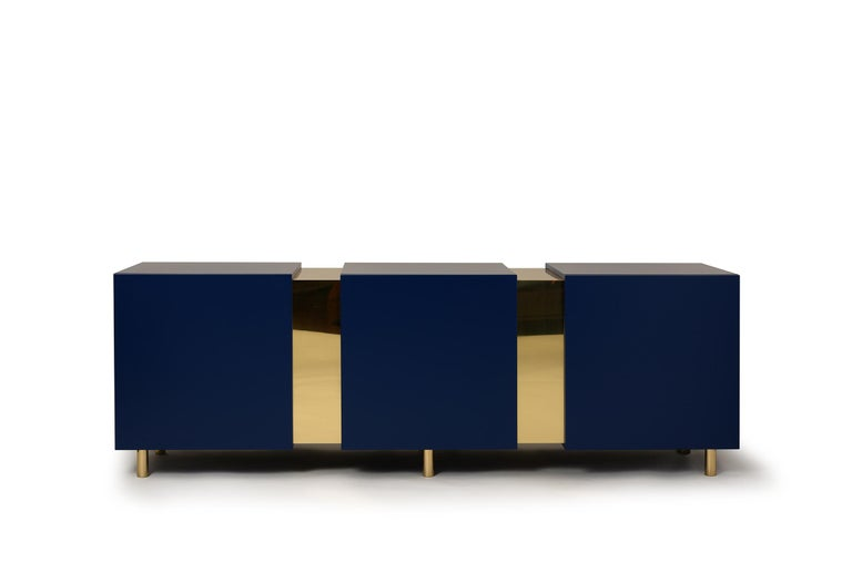 Eunduetrè is a low storage system which punctuates the space and plays with contrasting effects. Extremely simple in its geometric shapes, this sideboard/credenza alternates colorful cubes in matt lacquered wood, with sections of bent brass sheet