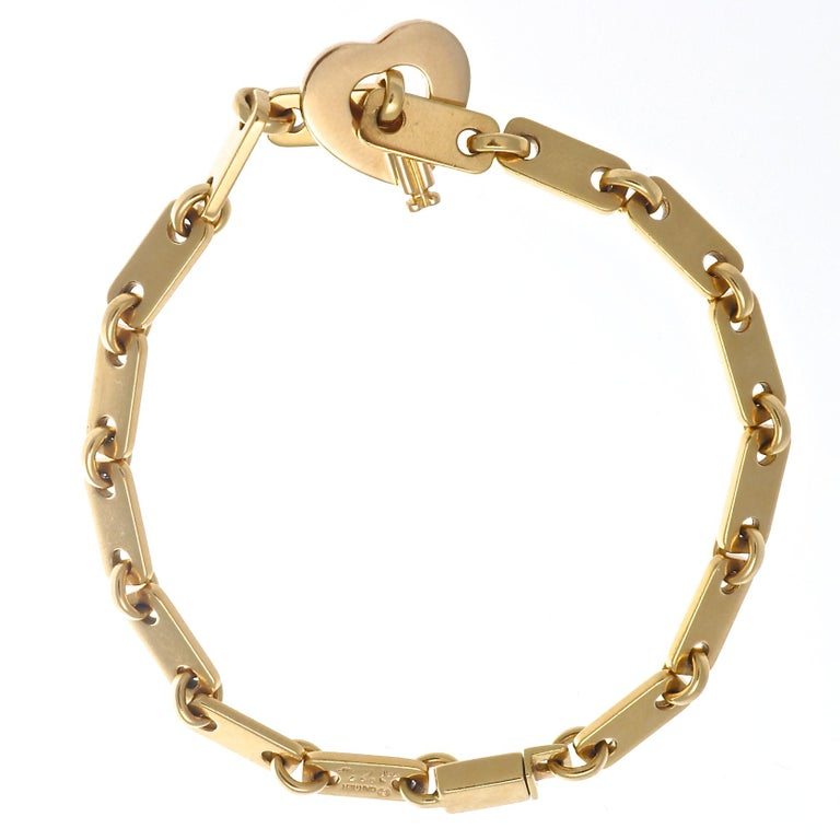The perfect 18k gold link bracelet with a beautiful open heart clasp, from Cartier France. Circa 1997, and measures 7 1/4 inches long. Signed Cartier and includes serial numbers. Add to your wrist stack or wear it alone, but wear it everyday to keep