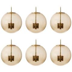 Six Large Limburg Globe Pendant Lights, Brass Amber Smoked Glass, 1970s